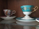 This blue tea cup only comes down to that gold line. The saucer reaches up for it. It's pretty cool.