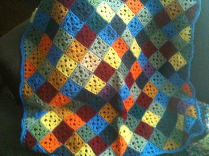 I finished this afghan for my cousin. It is literally my favorite easy afghan I've ever done. I tweaked the pattern a little from the Charlie Brown afghan, to make the half and quarter squares a bit more substantial. And now I think the pattern is perfect. It's amazing how granny squares tilted looks so different.