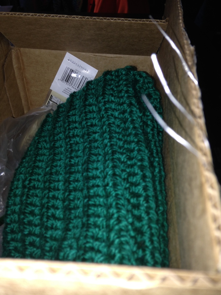 The Butcher's scarf, a simple half-double crochet in green. Just waiting on the last skein to finish it up.