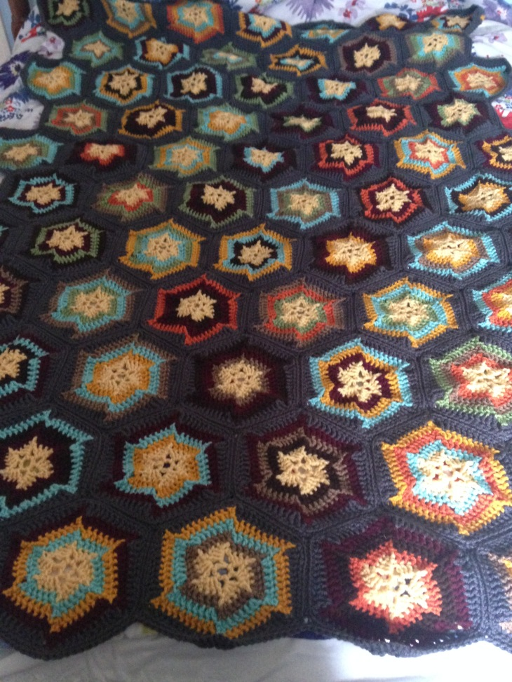 The afghan is finished! I'm trying not to be too judgmental, but I'm not in love with the way I mixed the hexagons. I'm probably the only one who will be dissatisfied with it, though, so I'm just going to stop being so nitpicky.