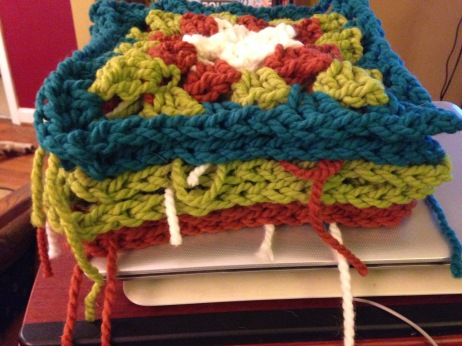 Sam's hiliarious Granny Square afghan continues apace. It's going to be thirty squares, so here's a fifth of them (I swear, though it doesn't look like it, this pile contains six squares).
